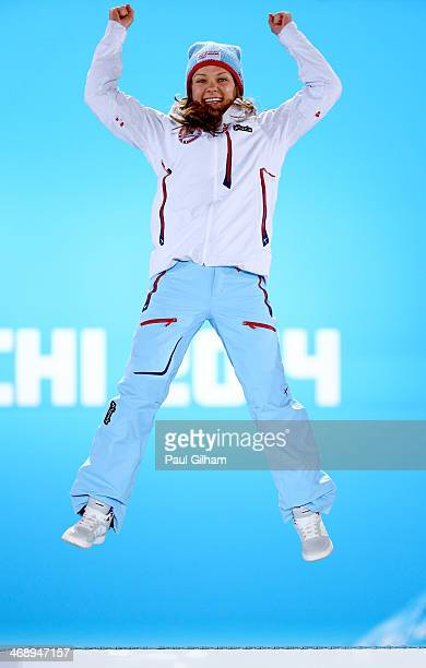 Gold medalist Maiken Caspersen Falla of Norway celebrates during the medal ceremony for the Ladies' Sprint Free on day five of the Sochi 2014 Winter...