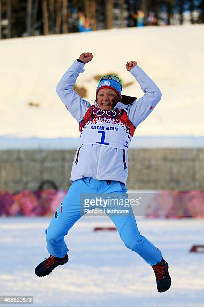 Gold medalist Maiken Caspersen Falla of Norway celebrates on the podium during the flower ceremony for the Finals of the Ladies' Sprint Free during...
