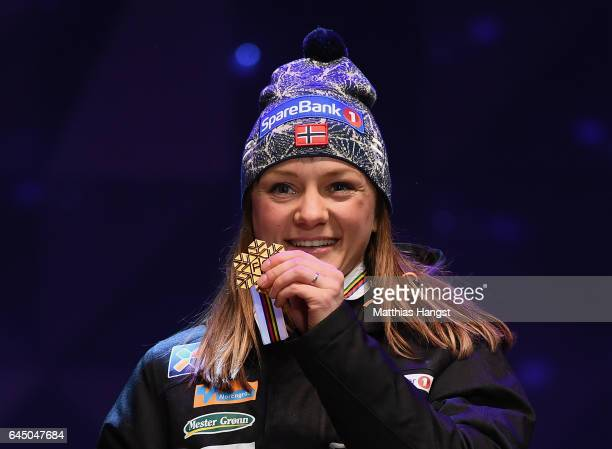 Gold medalist Maiken Caspersen Falla of Norway poses with her medal during the medal ceremony after the Women's 1.4KM Cross Country Sprint final...