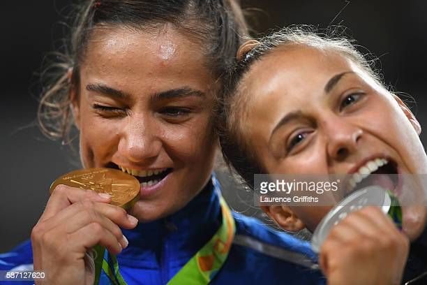 Gold medalist Majlinda Kelmendi of Kosovo and silver medalist Odette Giuffrida of Italy pose on the podium during the medal ceremony for the Women's...