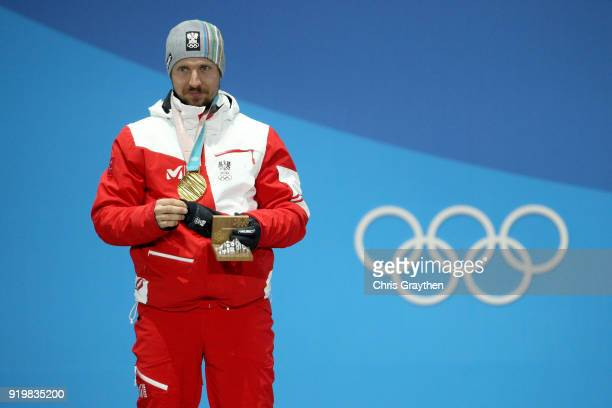 Gold medalist Marcel Hirscher of Austria celebrates during the medal ceremony for the Alpine Skiing Men's Giant Slalom on day nine of the PyeongChang...