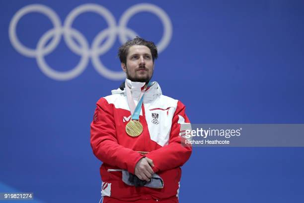 Gold medalist Marcel Hirscher of Austria stands during the medal ceremony for the Alpine Skiing Men's Giant Slalom on day nine of the PyeongChang...