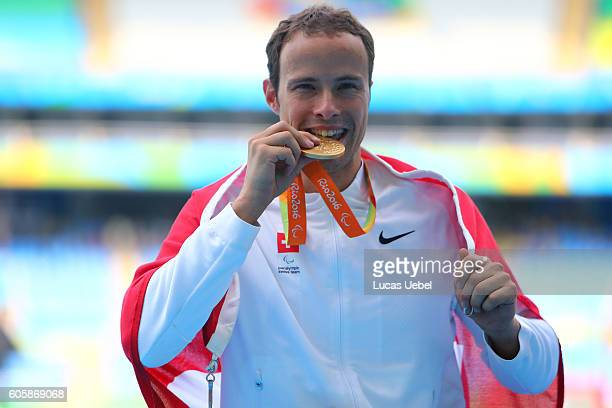 Gold medalist Marcel Hug of Swiss poses on the podium at the medal ceremony for Men's 800m T54 during day 8 of the Rio 2016 Paralympic Games at the...