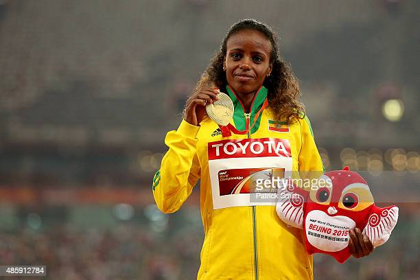 Gold medalist Mare Dibaba of Ethiopia poses on the podium during the medal ceremony for the Women's Marathon final during day nine of the 15th IAAF...