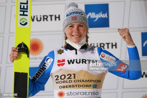 Gold medalist Maren Lundby of Norway celebrates during the flower ceremony for the Women's Ski Jumping HS137 competition at the FIS Nordic World Ski...