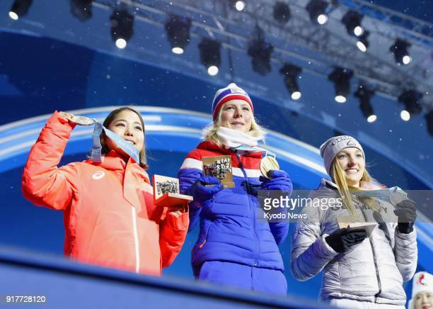Gold medalist Maren Lundby of Norway silver medalist Katharina Althaus of Germany and bronze medalist Sara Takanashi of Japan attend the medal...