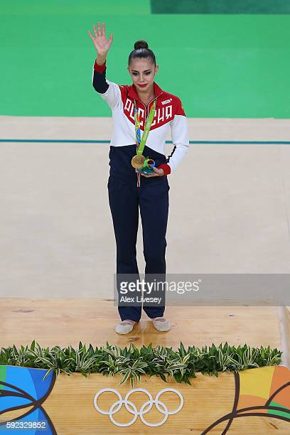Gold medalist Margarita Mamun of Russia celebrates on the podium during the Women's Individual AllAround Rhythmic Gymnastics Final on Day 15 of the...