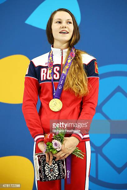 Gold medalist Maria Astashkina of Russia stands on the podium during medal ceremony for the Women's 50m Breaststroke on day eleven of the Baku 2015...
