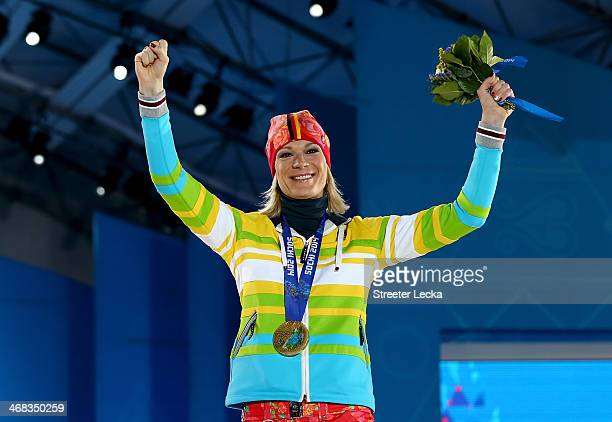 Gold medalist Maria HoeflRiesch of Germany celebrates during the medal ceremony for the Alpine Skiing Women's Super Combined on day 3 of the Sochi...