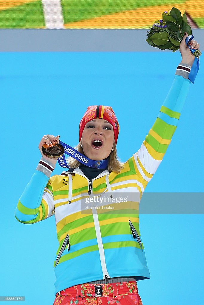 Gold medalist Maria Hoefl-Riesch of Germany celebrates during the medal ceremony for the Alpine Skiing Women's Super Combined on day 3 of the Sochi 2014 Winter Olympics at Medals Plaza in the Olympic Park on February 10, 2014 in Sochi, Russia.