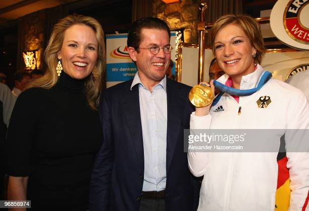 Gold medalist Maria Riesch of Germany poses with German Defense Minister KarlTheodor zu Guttenberg and his wife Stephanie zu Guttenberg and her gold...