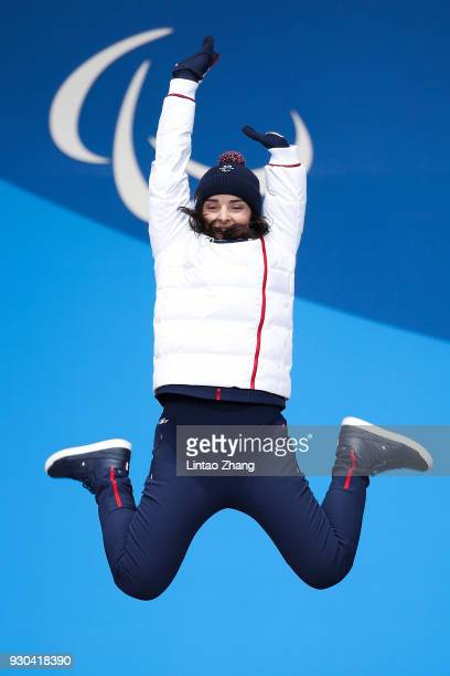 Gold Medalist Marie Bochet of France celebrate during the victory ceremony of the Women's SuperG Standing Alpine Skiing during day two of the...