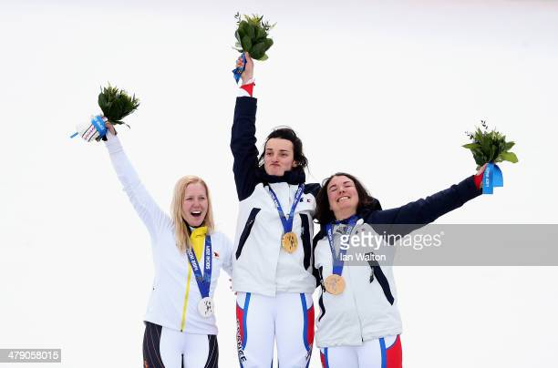 Gold medalist Marie Bochet of France celebrates with silver medalist Andrea Rothfuss of Germany and bronze medalist Solene Jambaque of France during...