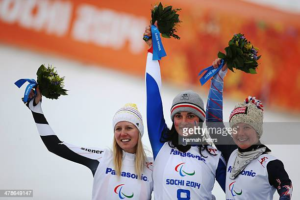 Gold medalist Marie Bochet of France poses with silver medalist Andrea Rothfuss of Germany and bronze medalist Stephanie Jallen of the United States...