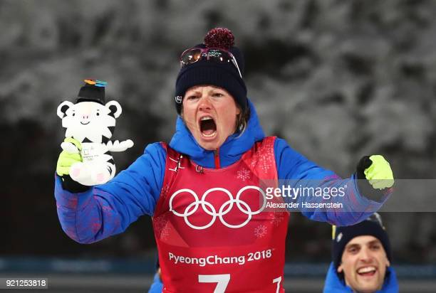 Gold medalist Marie Dorin Habert of France celebrates during the victory ceremony after the Biathlon 2x6km Women 2x75km Men Mixed Relay on day 11 of...
