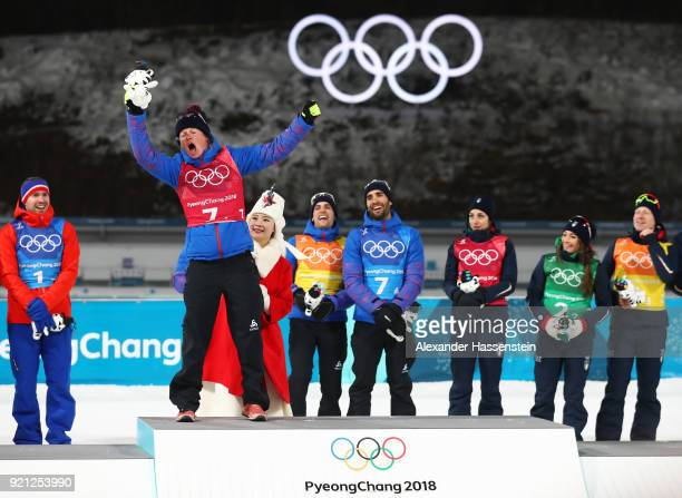 Gold medalist Marie Dorin Habert of France celebrates on the podium during the victory ceremony after the Biathlon 2x6km Women 2x75km Men Mixed Relay...