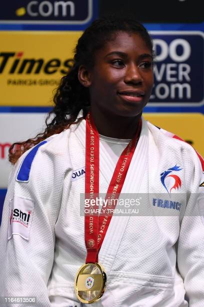 Gold medalist Marie Eve Gahie of France poses on the podium of the women's under 70kg category during the 2019 Judo World Championships at the Nippon...