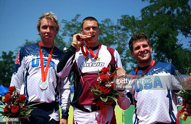 Gold medalist Maris Strombergs of Latvia silver medalist Mike Day of the United States and bronze medalist Donny Robinson of the United States pose...