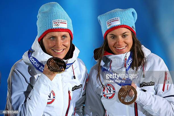 Gold medalist Marit Bjoergen of Norway and bronze medalist Heidi Weng of Norway on the podium during the medal ceremony for the for the for the...