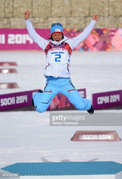 Gold medalist Marit Bjoergen of Norway celebrates during the flower ceremony for the Women's 30 km Mass Start Free during day 15 of the Sochi 2014...
