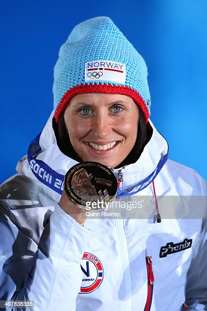 Gold medalist Marit Bjoergen of Norway celebrates during the medal ceremony for the Women's Skiathlon 7.5km Classic & 7.5km Free during day 1 of the...
