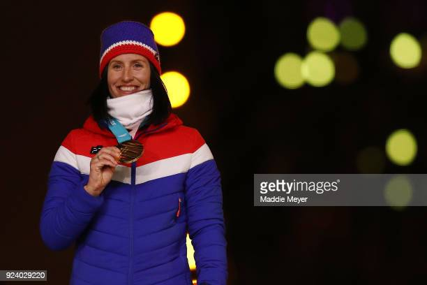 Gold medalist Marit Bjorgen of Norway poses during the medal ceremony for the Cross-Country Skiing - Ladies' 30km Mass Start Classic during the...