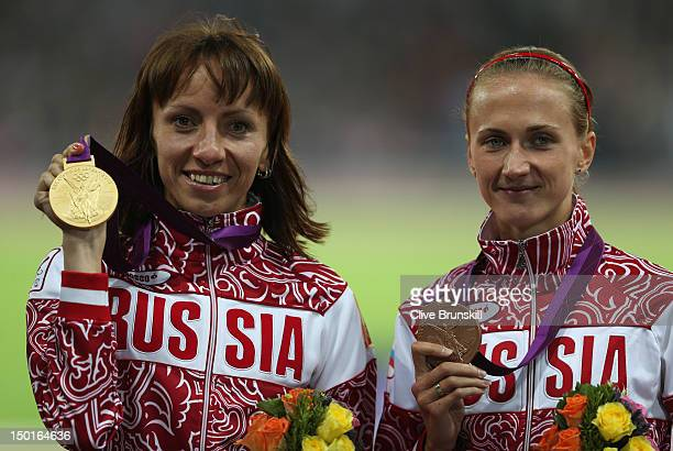Gold medalist Mariya Savinova of Russia and bronze medalist Ekaterina Poistogova of Russia pose on the podium during the medal ceremony for the...