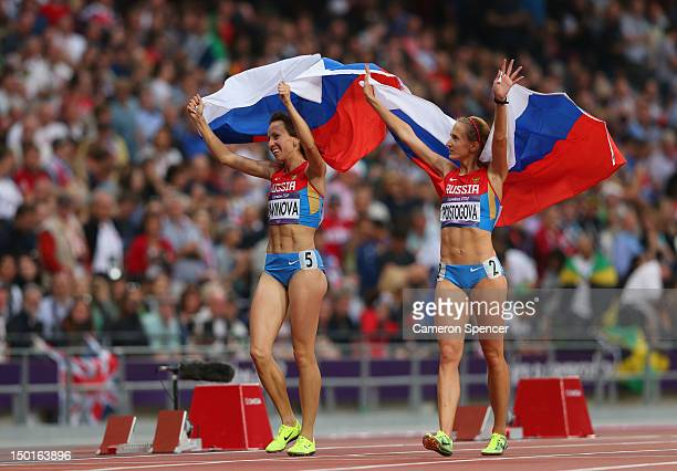 Gold medalist Mariya Savinova of Russia celebrates with bronze medalist Ekaterina Poistogova of Russia after the Women's 800m Final on Day 15 of the...