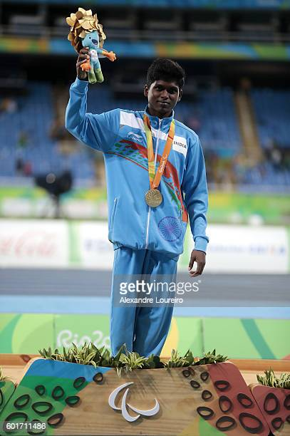 Gold medalist Mariyappan Thagavelu of India celebrate on the podium at the medal ceremony for the Men's High Jump F42 Final during day 2 of the Rio...