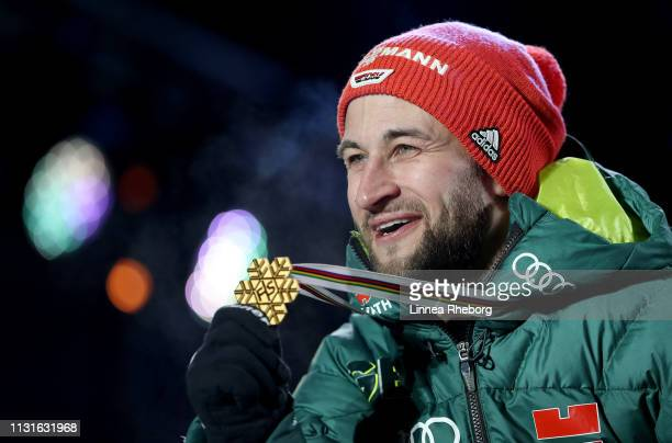 Gold medalist Markus Eisenbichler of Germany celebrates during the medal ceremony for the Ski Jumping Large Hill HS130 competition of the FIS Nordic...