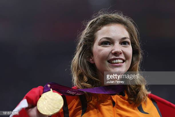 Gold medalist Marlou Van Rhijn of Netherlands poses on the podium during the medal ceremony for the Women's 200m T44 Final on day 8 of the London...