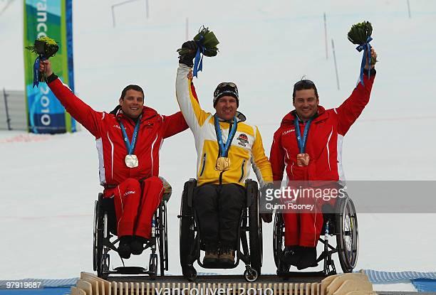 Gold medalist Martin Braxenthaler of Germany celebrates with silver medalist Jurgen Egle of Austria and bronze medalist Philipp Bonadimann of Austria...
