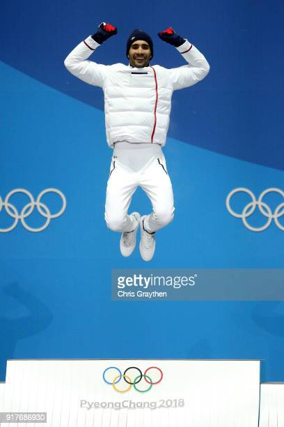 Gold medalist Martin Fourcade of France celebrate during the medal ceremony after the Men's Biathlon 125km Pursuit on day four of the PyeongChang...