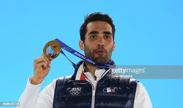 Gold medalist Martin Fourcade of France celebrates during the medal ceremony for the Men's 125 km Pursuit on day 4 of the Sochi 2014 Winter Olympics...