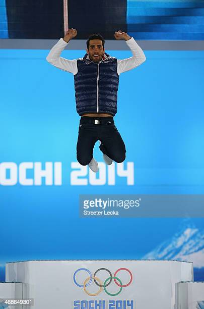 Gold medalist Martin Fourcade of France celebrates during the medal ceremony for the Men's 12.5 km Pursuit on day 4 of the Sochi 2014 Winter Olympics...