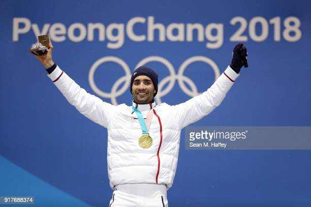 Gold medalist Martin Fourcade of France celebrates during the medal ceremony for the Men's Biathlon 12.5km Pursuit on day four of the PyeongChang...