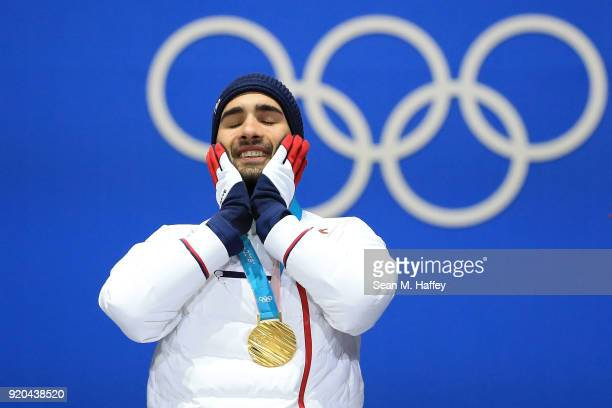 Gold medalist Martin Fourcade of France celebrates during the medal ceremony for the Biathlon Men's 15km Mass Start on day 10 of the PyeongChang 2018...
