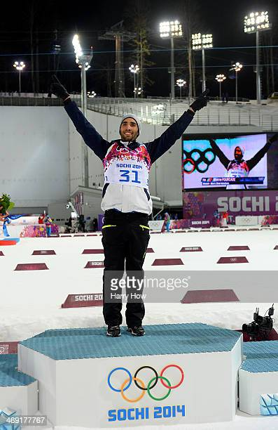 Gold medalist Martin Fourcade of France celebrates on the podium during the flower ceremony for the Men's Individual 20 km during day six of the...