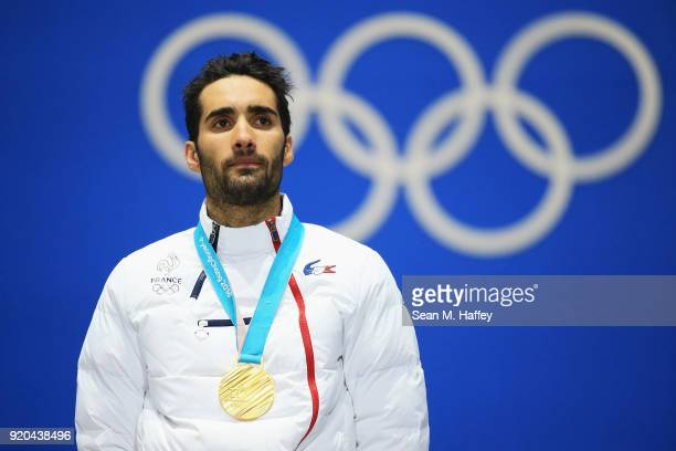 Gold medalist Martin Fourcade of France stands during the medal ceremony for the Biathlon Men's 15km Mass Start on day 10 of the PyeongChang 2018...