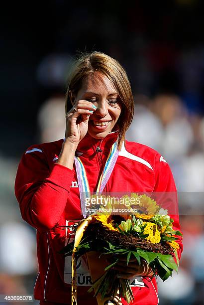 Gold medalist Maryna Arzamasova of Belarus shows her emotions as she stands on the podium during the medal ceremony for the Women's 800 metres final...
