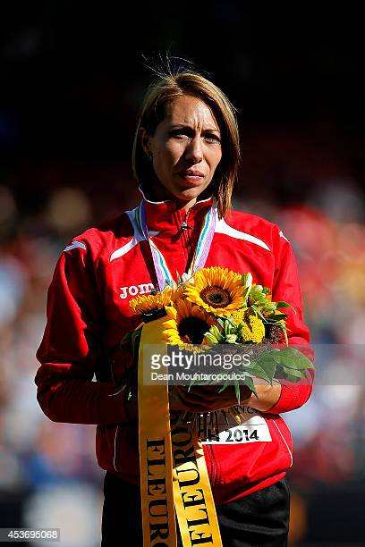 Gold medalist Maryna Arzamasova of Belarus stands on the podium during the medal ceremony for the Women's 800 metres final during day five of the...