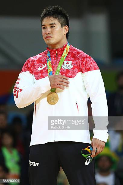 Gold medalist Mashu Baker of Japan stands on the podium during the medal ceremony for the Men's 90kg Judo on Day 5 of the Rio 2016 Olympic Games at...