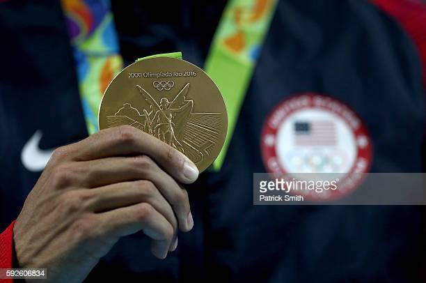 Gold medalist Matthew Centrowitz of the United States stands on the podium during the medal ceremony for the Men's 1500 meter on Day 15 of the Rio...