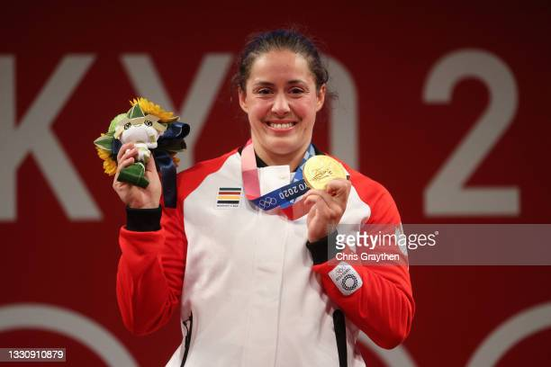 Gold medalist Maude G Charron of Team Canada poses with the gold medal during the medal ceremony for the Weightlifting - Women's 64kg Group A on day...