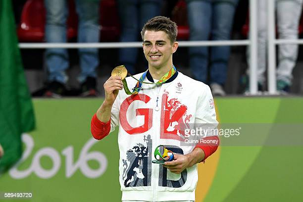 Gold medalist Max Whitlock of Great Britain celebrates on the podium at the medal ceremony for Men's Floor Exercise on Day 9 of the Rio 2016 Olympic...