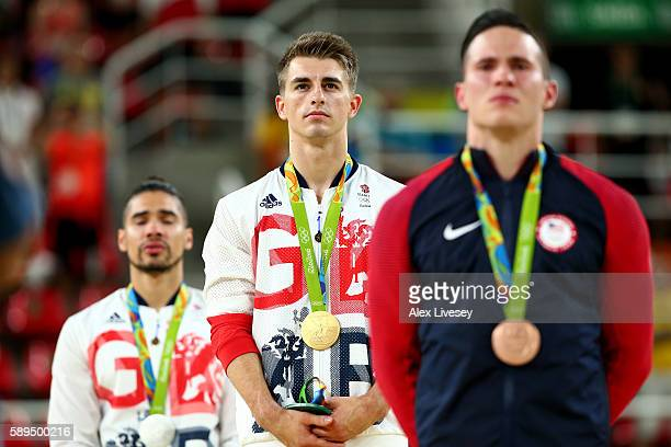 Gold medalist Max Whitlock of Great Britain stands on the podium for the national anthem at the medal ceremony for Men's Pommel Horse on Day 9 of the...