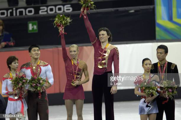 Gold medalist Maxim Marinin and his partner Tatiana Totmianina receive their gold medal along with silver medalists Dan Zhang and Hao Zhang left and...