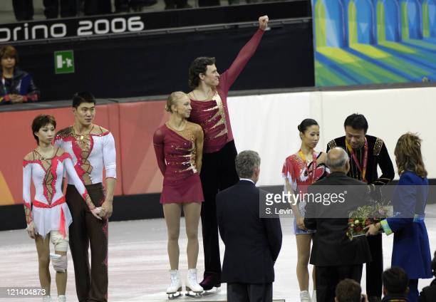 Gold medalist Maxim Marinin and his partner Tatiana Totmianina wave to the crowd along with silver medalists Dan Zhang and Hao Zhang left and bronze...