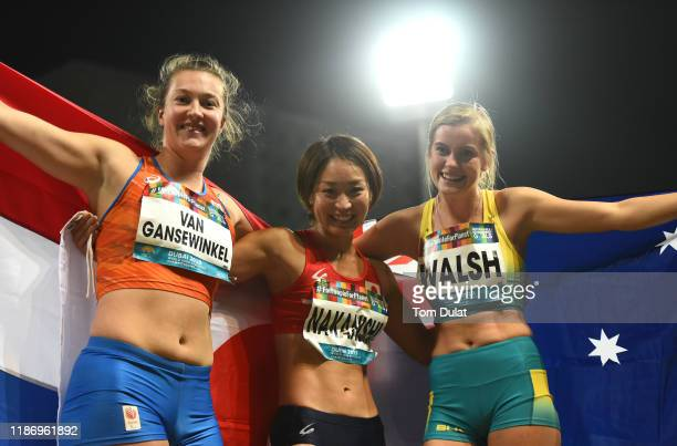 Gold medalist Maya Nakanishi of Japan poses with Marlene van Gansewinkel of Netherlands and Sarah Walsh of Australia after the Women's Long Jump T64...