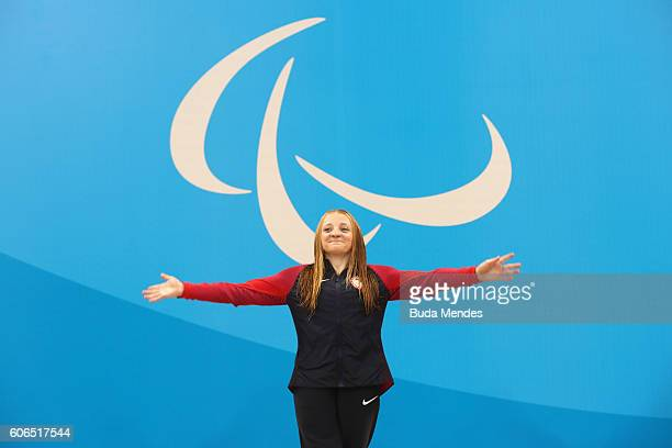 Gold medalist McKenzie Coan of the United States celebrates on the podium at the medal ceremony for the Women's 100m Freestyle S7 on day 9 of the Rio...